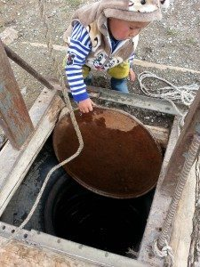 The 2nd youngest getting water from the well