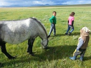 3 of the kids and a horse