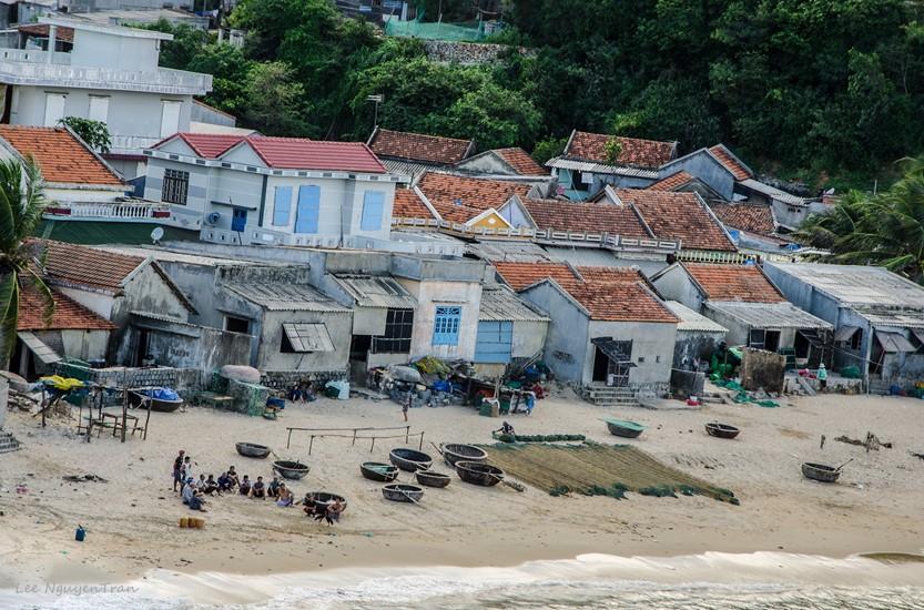 fishermen getting ready in the morning at red reef beach, phu yen, vietnam